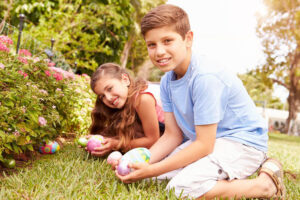 Kids playing with Easter eggs in the backyard