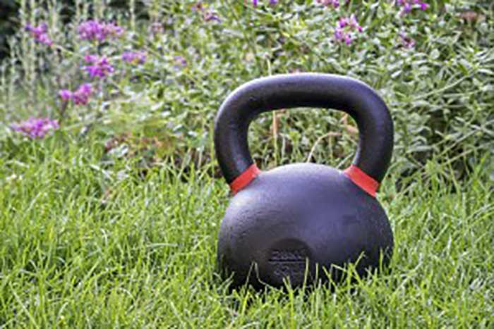kettlebells in backyard