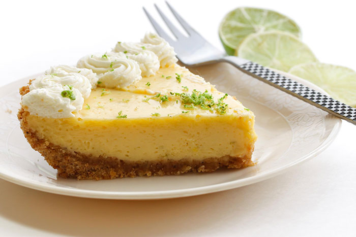 Lime pie in a plate with a fork